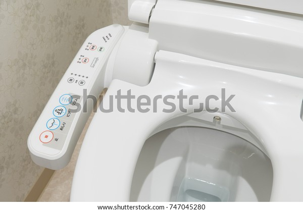 TOKYO, JAPAN - October  26, 2017: Modern high tech toilet with electronic bidet in Japan. Industry leaders recently agreed on signage standards for Japanese toilet bowls.