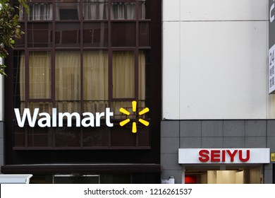 TOKYO, JAPAN - October 26, 2018: Signs on the front of branch of the supermarkt chain Seiyu, one for Seiyu, the other for its owner Walmart, in Akabane in Tokyo.