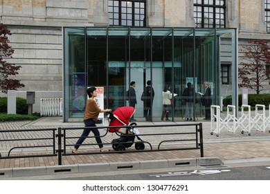 TOKYO, JAPAN - October 26, 2018: The front of Tokyo's International Library of Children's Literature. The  renovation of the building was designed by Tadao Ando. Some motion blur.