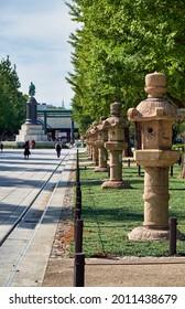 Tokyo, Japan - October 26, 2019:  The Kasuga-doro stone lanterns along road to Yasukuni Shrine. Chiyoda. Tokyo. Japan