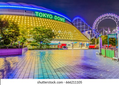 Tokyo, Japan - October 28, 2013: Night view of Tokyo Dome, the baseball stadium with 55000 seated and opened in 1988. Its dome-shaped roof is an air-supported structure with the flexible membrane.