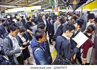 TOKYO, JAPAN - OCTOBER 28. 2014: Passengers hurry at Akihabara crowd station in Tokyo, Japan.   Akihabara is one of the world's few Electric Towns