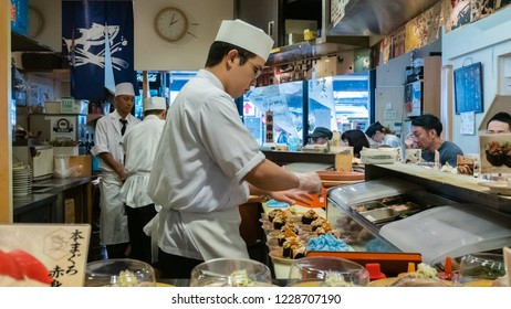 Tokyo, Japan - October 29, 2018: Sushi chef making sushi in the restaurant in Tokyo, Japan