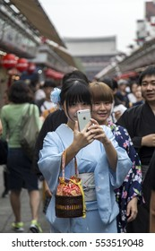 TOKYO, JAPAN - OCTOBER 3, 2016: Unindetified people at Asakusa temple in Tokyo, Japan. It is Tokyo oldest and one of most significant temples.
