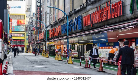 Tokyo, Japan - october 30 2013 : people walking in the street in the front of the famous yodobashi camera electronics store in Shinjyuku