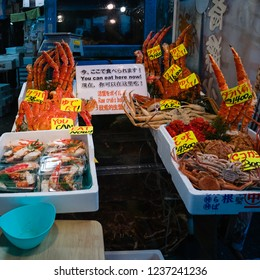 Tokyo, Japan - October 30, 2018: Vendor in Tsukiji Fish Market in Tokyo, Japan. It is the biggest wholesale fish and seafood market in the world.
