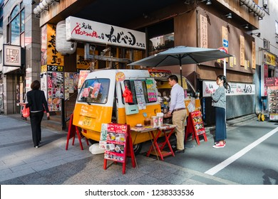 Tokyo, Japan - October 30, 2018: Customer buying food at Car food vendor at Shibadaimon area in Minato district, Tokyo, Japan