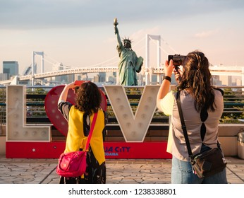 Tokyo, Japan - October 30, 2018: Tourist taking picture of Statue of Liberty in Odaiba area, Tokyo, Japan
