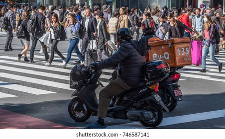 TOKYO, JAPAN - OCTOBER 30TH, 2017. Motorcyclist stopping at the famous Shibuya scramble pedestrian crossing.