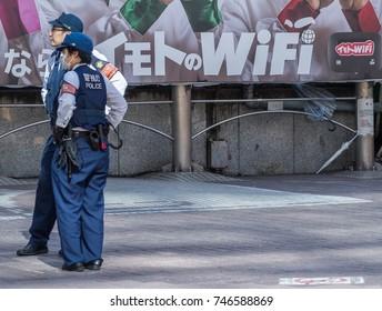 TOKYO, JAPAN - OCTOBER 30TH, 2017. Japanese police on beat patrol in Shibuya street.