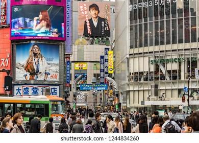 Tokyo, Japan - october 31 2013 : crowd of people walking through Shibuya scramble crossing