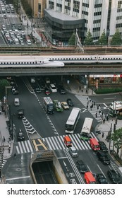 Tokyo, Japan - October 31, 2019 : Shinkansen (Japanese Bullet Train) on a track, top view from  Tokyu Plaza Ginza rooftop in Tokyo. Some motion blur.