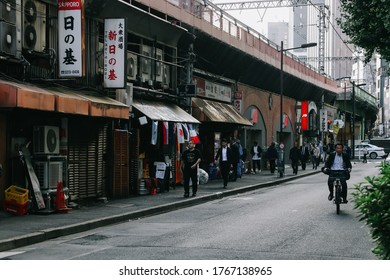 Tokyo, Japan - October 31, 2019: Street view of many people around Yurakucho station on the evening. Soft focus, selective focus. Vintage tone.