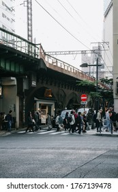 Tokyo, Japan - October 31, 2019: Blur image of many people at Yurakucho alley on the evening. Soft focus, selective focus. Vintage tone.