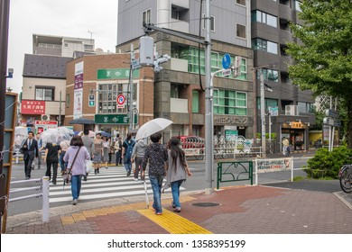 Tokyo, Japan: October 4, 2018: Traffic and urban life in Tokyo, Japan.  Tokyo has a population of 9.27 million people.