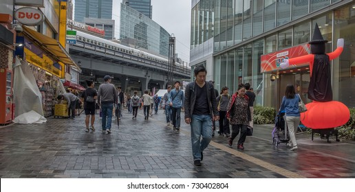 TOKYO, JAPAN - OCTOBER 7TH, 2017. People walking in the front of the Yurakucho train station in the morning.