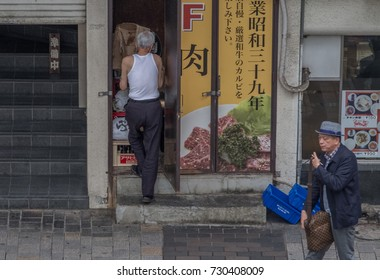 TOKYO, JAPAN - OCTOBER 7TH, 2017. Old Japanese man working at the backalley of Yurakucho district.