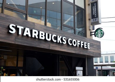 Tokyo, Japan - October, 8 2016: Starbucks exterior logo. Starbucks is a chain of coffee shops.