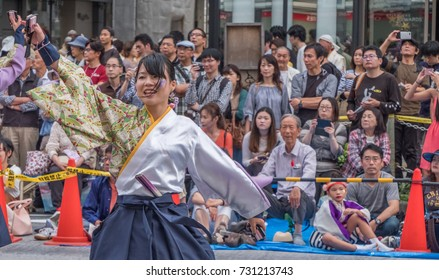 TOKYO, JAPAN - OCTOBER 8TH, 2017. Yosakoi dancers in fancy costume aperforming their routine at during the Annual Fukuro Festival.