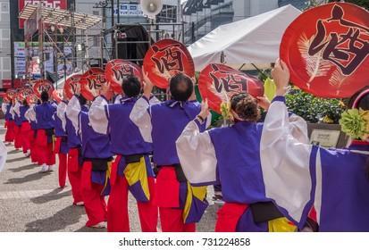 TOKYO, JAPAN - OCTOBER 8TH, 2017. Yosakoi dancers in fancy costume aperforming their routine at during the Annual Fukuro Festival.
