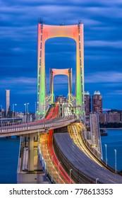 Tokyo, Japan at Rainbow Bridge at night.