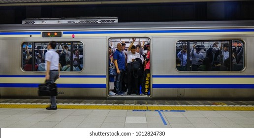 Tokyo, Japan - Sep 29, 2017. Passengers standing on train at metro station in Tokyo, Japan. Rail transport in Japan is a major means of passenger transport.
