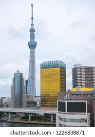 tokyo, Japan. Sepember 13, 2018. : Tokyo skyscraper across the river in Asakusa including the Tokyo Skytree and the Asahi Beer Hall in Tokyo, Japan