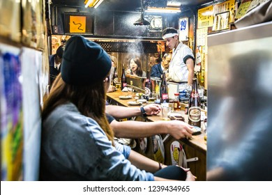 Tokyo, Japan - Sept 21st 2018 - Locals japaneses having a meal in a local traditional restaurant in downtown Tokyo in Japan
