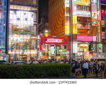 Tokyo, Japan. September 11, 2018. Crowds pass through Kabukicho in the Shinjuku district. The area is an entertainment and red-light district.