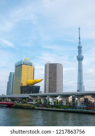 Tokyo, Japan - September 12, 2018: View of the Tokyo skyline from across the river in Asakusa including the Tokyo Skytree and the Asahi Beer Hall