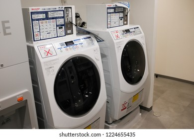 Tokyo, Japan - September 15, 2018 : View of Sharp brand of washing machine for public use in a hotel at Ueno