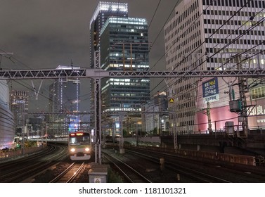 TOKYO, JAPAN - SEPTEMBER 15TH, 2018. Blurred motion of East Japan Railway Yamanote line passing thorugh Yurakucho Station tracks at night. Long exposure.