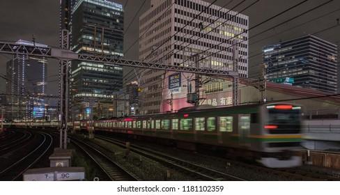 TOKYO, JAPAN - SEPTEMBER 15TH, 2018. Blurrred motion of East Japan Railway Shonan Shinjuku line passing thorugh Yurakucho Station tracks at night. Long exposure time.