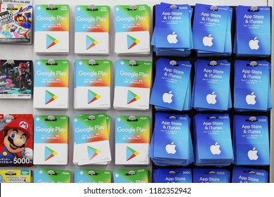 TOKYO, JAPAN - September 16, 2018: A 7-Eleven convenience store's racks with various types of prepaid gift cards including Google Play and Apple's App & iTunes stores.