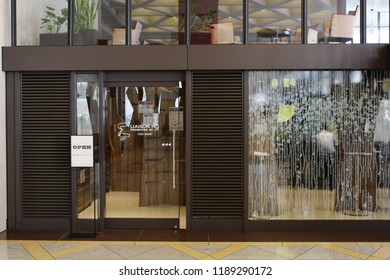 TOKYO, JAPAN - September 16, 2018: The front of a modern enclosed smoking room in the 147m 36-story 1968 Kasumigaseki Building.
