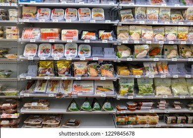 Tokyo, Japan - September 16, 2018 : Assorted brands of pre-pack microwave ready-to-eat food for sale in a 7-Eleven convenience store at Ueno
