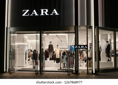 TOKYO, JAPAN - September 16, 2018: The entrance and interior of a Zara clothes store in Toyko's Roppongi Hills at night.