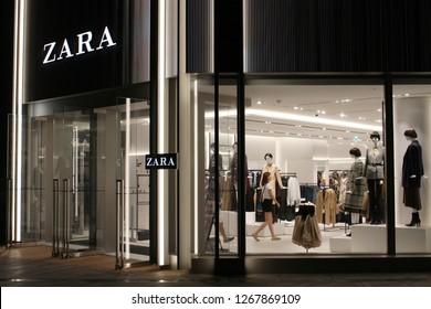 TOKYO, JAPAN - September 16, 2018: The front and side of a Zara clothes store in Toyko's Roppongi Hills at night.