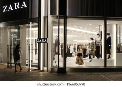 TOKYO, JAPAN - September 16, 2018: The front of a Zara clothes store in Toyko's Roppongi Hills at night.