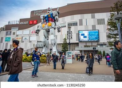 Tokyo, Japan - September 19 2017: Full size Gundam Performances Outside DiverCity Tokyo Plaza. It is 18m tall The sculpture of famous anime franchise robot, Gundam.