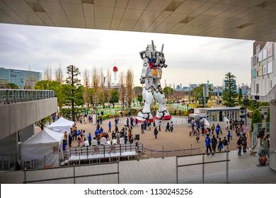 Tokyo, Japan - September 19, 2017: Full size Gundam Performances Outside DiverCity Tokyo Plaza. It is 18m tall The sculpture of famous anime franchise robot, Gundam.