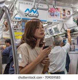 TOKYO, JAPAN - SEPTEMBER 1ST, 2017. Commuters in Tokyo Metro subway train.