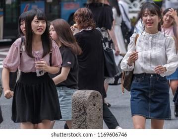 TOKYO, JAPAN - SEPTEMBER 1ST, 2018. A group of Japanese girls walking at Shibuya Center Gai street during the day.