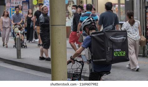 TOKYO, JAPAN - SEPTEMBER 1ST, 2018. Uber Eats bicycle rider at Center Gai street, Shibuya.