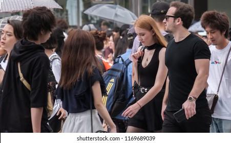 TOKYO, JAPAN - SEPTEMBER 1ST, 2018. Pedestrian crossing the famous scramble crosswalk in Shibuya.