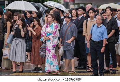 TOKYO, JAPAN - SEPTEMBER 1ST. Female tourist wearing yukata in the street of Shibuya.
