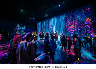 Tokyo, Japan- september 20, 2018: Panoramic view of an incredible interactive hall in the Mori Digital Art Museum full of people enjoying the exhibition