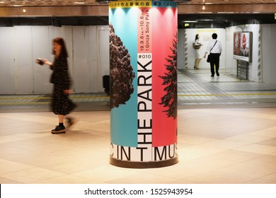 TOKYO, JAPAN - September 20, 2019: A pillar in a subterranean concourse with an advert for a Tokyo Ska Paradise Orchestra Music in the Park exhibition being held in Ginza Sony Park. Some motion blur.