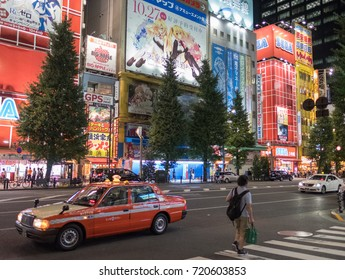TOKYO, JAPAN - SEPTEMBER 21ST, 2017. Taxi in the street of Akihabara Electric Town at night.