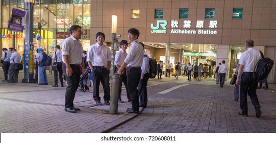 TOKYO, JAPAN - SEPTEMBER 21ST, 2017. Japanese white collar employee or salaryman at Akihabara street at night.
